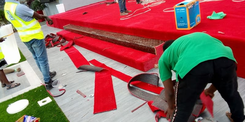 Artificial Red Grass Installation On Church Alter