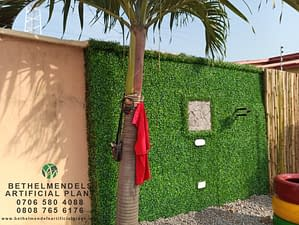 Installation Of Artificial Boxwood On The wall At Ojodu
