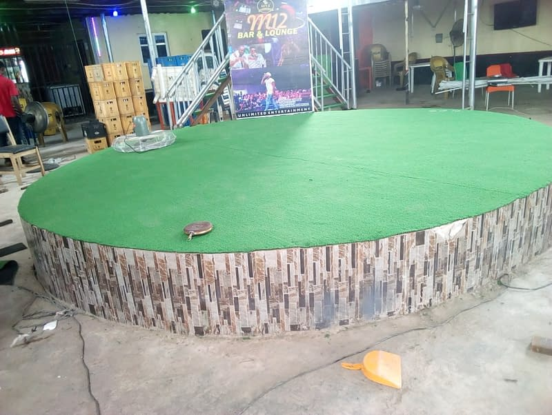 Event Stage DecorateAd with Artificial Grass in Sango, Ota, Ogun State.